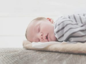 This image has an empty alt attribute; its file name is close-up-photo-of-sleeping-baby-300x225.jpg